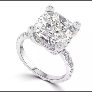 Lab created 3 carat cushion cut engagement ring.
